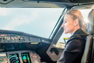 Employee story: Woman at the controls of an airplane